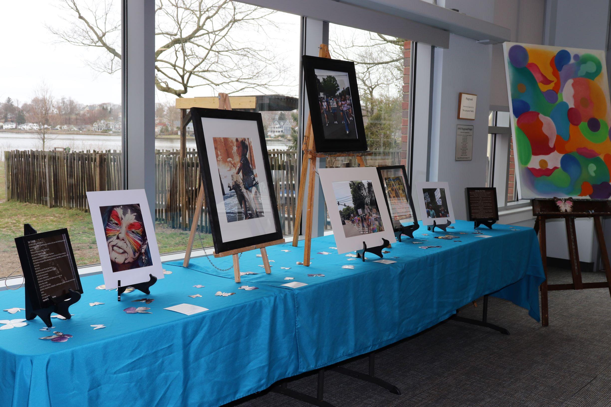 Ragetime Art Show table at Darien YMCA