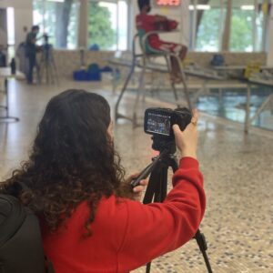 Women photographing the Darien Y pool for a Video Project with Norwalk Community College