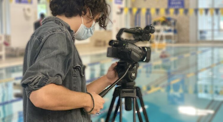 Young Man photographing the Darien Y pool for a Video Project with Norwalk Community College