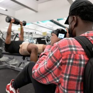African American Young Man photographing the Darien Gymnasium and Fitness Center for a Video Project with Norwalk Community College