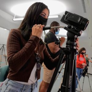 Women photographing the Darien YMCA Gymnastics Center for a Video Project with Norwalk Community College